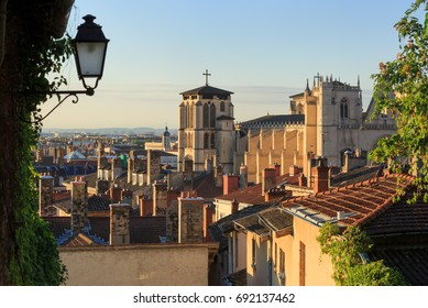 Lantern, rooftops and cathedral St. Jean Baptiste in Vieux Lyon, the old town of Lyon. France.