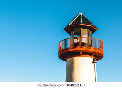 The lantern room at dawn of the iconic Oceanside Harbor faux lighthouse in Oceanside, California a city in San Diego County.