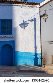 Lantern and its shadow on the blue street of Chefchaouen, Morocco