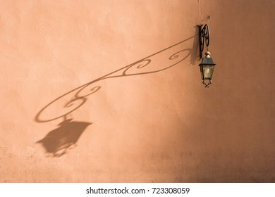 Lantern with shadow at the wall at Marrakech, Morocco