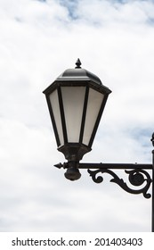 Lantern streetlights in retro style of execution against the sky