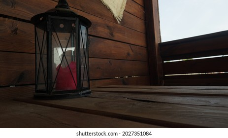lantern with unlit candles on the table