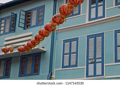 "Lanterns and Buildings, Chinatown, Singapore, Asia. TRANSLATION: writing on lanterns says ""Singapore 2018"""