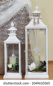 Lanterns with candles and flowers inside