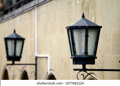 Lanterns on a wall outdoor during the day.