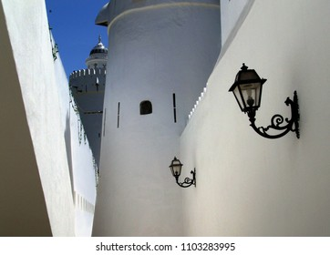 lanterns on a white wall of the fort Qasr al Hosn in Abu Dhabi
