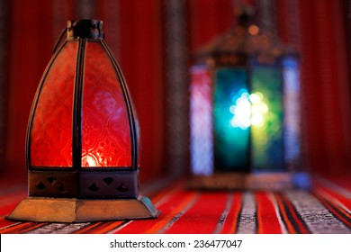 Lanterns placed on Arabian woven fabric. Lanterns are iconic symbols of Ramadan in the Middle East