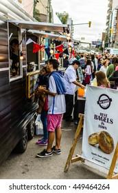 LANUS, ARGENTINA - APRIL 9, 2016: People buying street food at Buenos Aires Market of food trucks