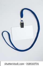 Lanyard and badge. Conference badge. Blank badge template on plastic card with blue strap.
