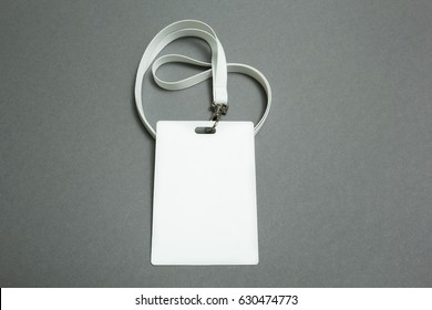 Lanyard and badge. Conference badge. Blank badge template on plastic card with white strap.