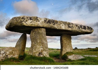 Lanyon Quoit dolmen neolithic tomb with three megalithic legs and 12 ton table capstone in Cornwall England at sunset