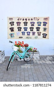LANZAROTE, CANARY ISLANDS - SEPTEMBER 2018 - Bicycle and flowers outside a mini shop in the town of Haria