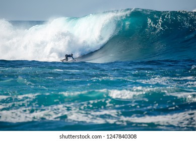 "lanzarote - november 29, 2018: surfer in the big wave, competition ""quemao class"" lanzarote, canary islands"