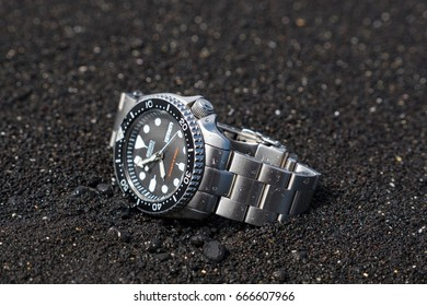 LANZAROTE, SPAIN - CIRCA JUNE, 2017: Seiko Diver 007 watch on a beach. Seiko is a Japanese company manufacturing watch products, jewelry, and precision instruments. Illustrative editorial.