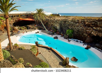Lanzarote, Spain - DECEMBER 02, 2017: Tourists are walking and taking pictures in Jameos del Agua garden in Lanzarote, Canary Islands, Spain