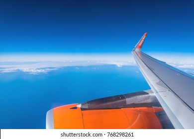 Lanzarote, Spain - December 20, 2016: easyJet logo on airplane's wing in mid-air over Atlantic Ocean. easyJet is a British low-cost airline and operates flights in more than 30 countries.
