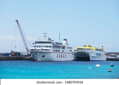 Lanzarote, Spain; July 10th 2019: The Fred Olsen ferry and ARMAS ferry in the harbour at Playa Blanca.
