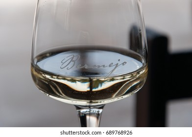 LANZAROTE, SPAIN - MAY 09 2017: Bermejo white wine glass of the Bodega Rubicon. Bodega Rubicon is one of the most important wineries of Lanzarote Island