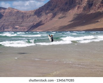 Lanzarote, Spain - May 31, 2017: Surfer on famara beach in the north part of the island