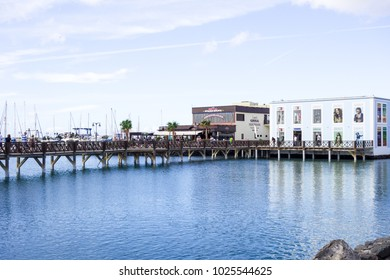 LANZAROTE, SPAIN-4th Nov 2017: Lani's Grill Stakehouse and Esprit retail store overlooks the harbour at the Marina Rubicon in Playa Blanca.
