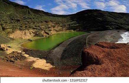 Lanzarote, volcanic crater with  green lake near El Golfo  (El Lago Verde, Charco de los Clicos),  Canary island, Spain