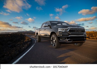 Lanzarote,Spain-January 2020:Dodge RAM 1500 on the road leading through the volcanic landscape of Lanzarote
