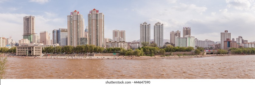 LANZHOU, CHINA-MAY 1,2016: The  Labor day in Lanzhou, China. People are resting by the river.