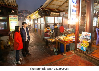 Lao Cai, Vietnam - FEBRUARY 27, 2012: Couple Vietnamese buying local food at the night market of Sa Pa, tourist attractions in Vietnam. Sa Pa.