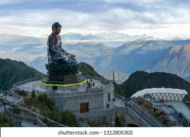 Lao Cai, Vietnam - Jan 3, 2019: Amitabha Buddha statue on top of Fansipan, the Roof of Indochina, in Sapa town, northen Vietnam. The highest bronze statue in Vietnam with 21.5m height