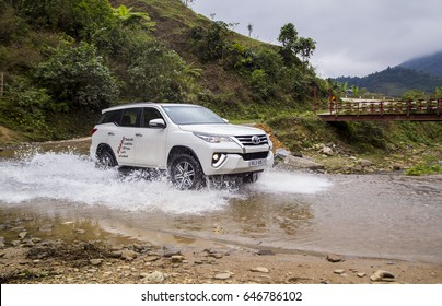 Lao Cai, Vietnam - Mar 17, 2017: Toyota Fortuner 2017 SUV in a test drive for ability on multi terrains in mountain are, Vietnam.