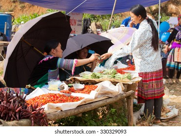 LAO CAI, VIETNAM - OCT 17, 2015: Hmong tribe people selling vegetable and other agriculture products at Can Cau flea market. Flea market is very popular as one kind of small business in Vietnam.
