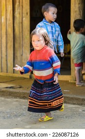 LAO CHAI VILLAGE, VIETNAM - SEP 22, 2014: Unidentified Hmong little girl on a break in a local primary school. Hmong is on of the minority eethnic group in Vietnam