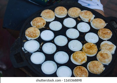Lao coconut pancakes made with sticky rice flour and coconut milk called Khao nom kok. Also called Khanom krok in thai