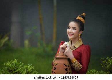 Lao girl dressed in traditional Lao clothes Beautiful Laos girl in Laos costume,Asian woman wearing traditional Laos culture,vintage style,traditional suit.