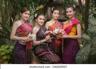 Lao girl dressed in traditional Lao clothes Beautiful Laos girl in Laos costume,Asian woman wearing traditional Laos culture,vintage style,traditional suit