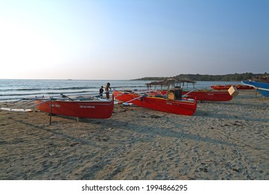 Laoag City, Philippines-March 16, 2005: Fishing boats and working fishermen moored by the sea