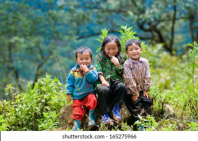 LAOCAI, VIETNAM, MAY 30: So, 4, Oc, 6, Ngao, 5, three ethnic children smile  on MAY 30, 2013 in Laocai, Vietnam. There are many ethnic minority groups in Laocai