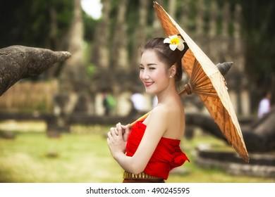Laos girls splashing water durin tradition festival Laos Vientiane