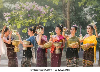 laos girls splashing water during festival Songkran festival