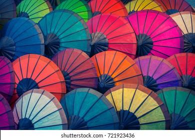 Laos, Luang Prabang. Many vintage parasols made of natural materials of different colors