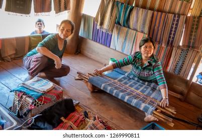 , laos - november 24, 2018: woman at the loom