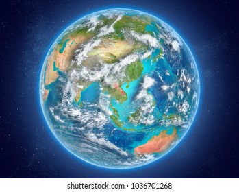 Laos in red on model of planet Earth with clouds and atmosphere in space. 3D illustration. Elements of this image furnished by NASA.
