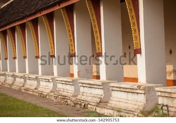 Laos, Wat That Luang temple walls.