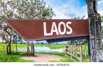 Laos wooden sign with rural background