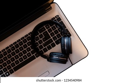 Lap top with headphones isolated on a white background