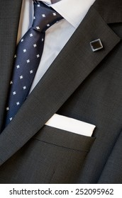 lapel, pocket square and tie