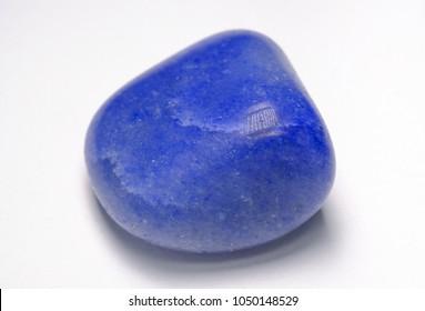 Lapis lazuli stone (blue stone) on white background