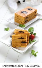 Lapis Legit or Thousand Layers Cake with prunes topping and filling, an Indonesian traditional cake