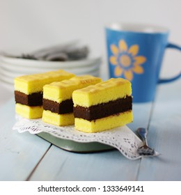 Lapis Surabaya or Surabaya layer cake, is an Indonesian three layer rich sponge cake with yellow-chocolate-yellow cake and strawberry jam in between