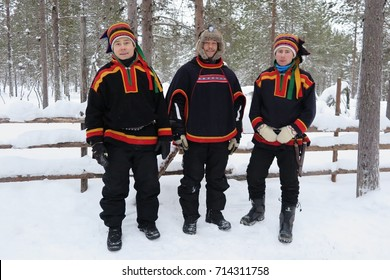 LAPLAND, FINLAND – FEBRUARY 2, 2017: Three Sami men in Finnish Lapland sport colorful woolen clothing. The patterns on their jackets are largely symbolic.